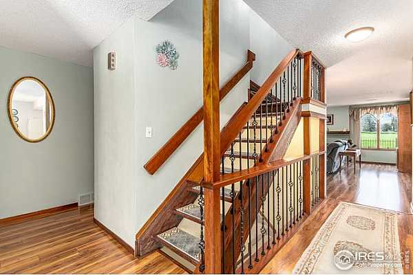 Photo #10 Open stairs and beautiful wrought iron detail