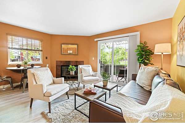 Photo #2 Colorful, cozy living space with gas fireplace