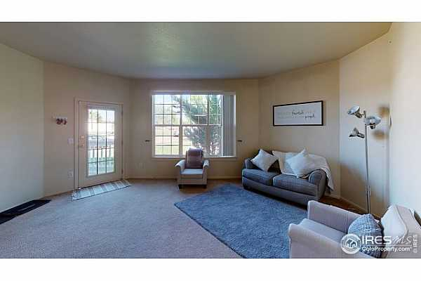 Photo #6 Walk out to covered patio from your living room