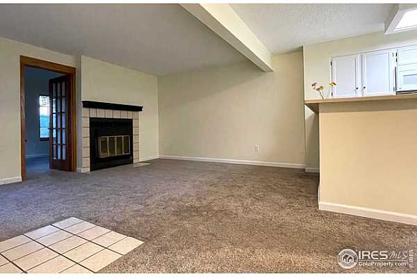 Photo #3 Plenty of space for sectional by wood-burning fireplace